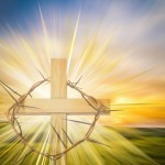 Happy Easter greeting card or background with a cross, crown of thorns and colorful abstract blur background like a meadow at sunset, with copy space for text.